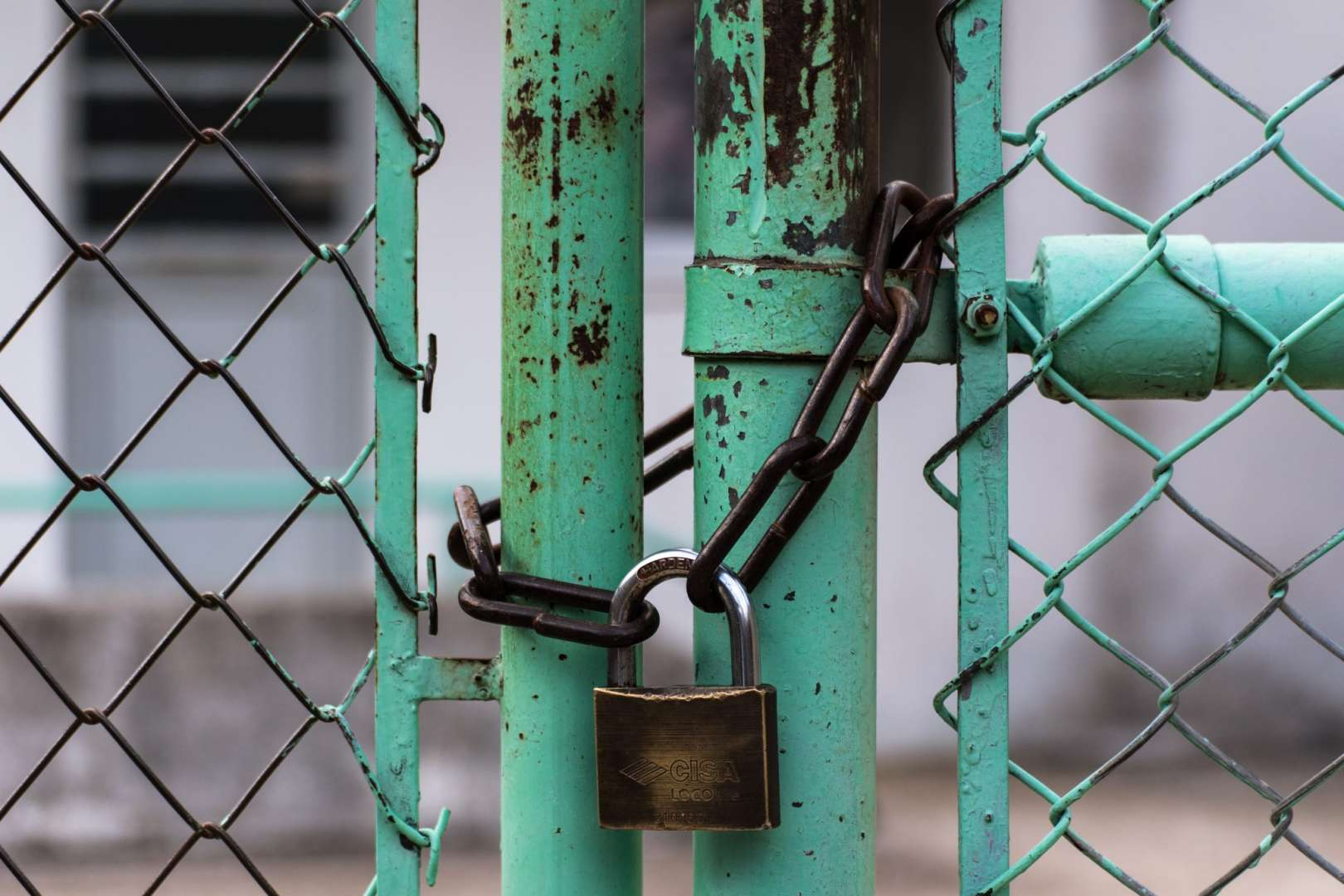 Padlock and Chain Securing a Business Entrance