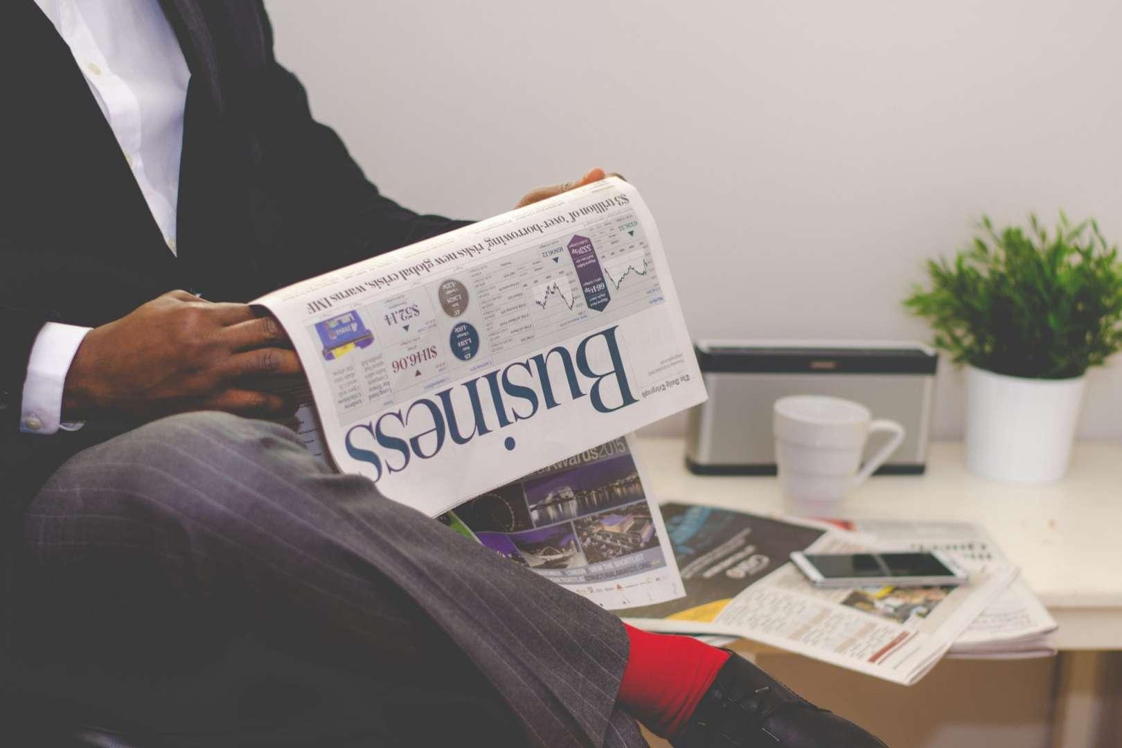 Man Reading Travel Business News