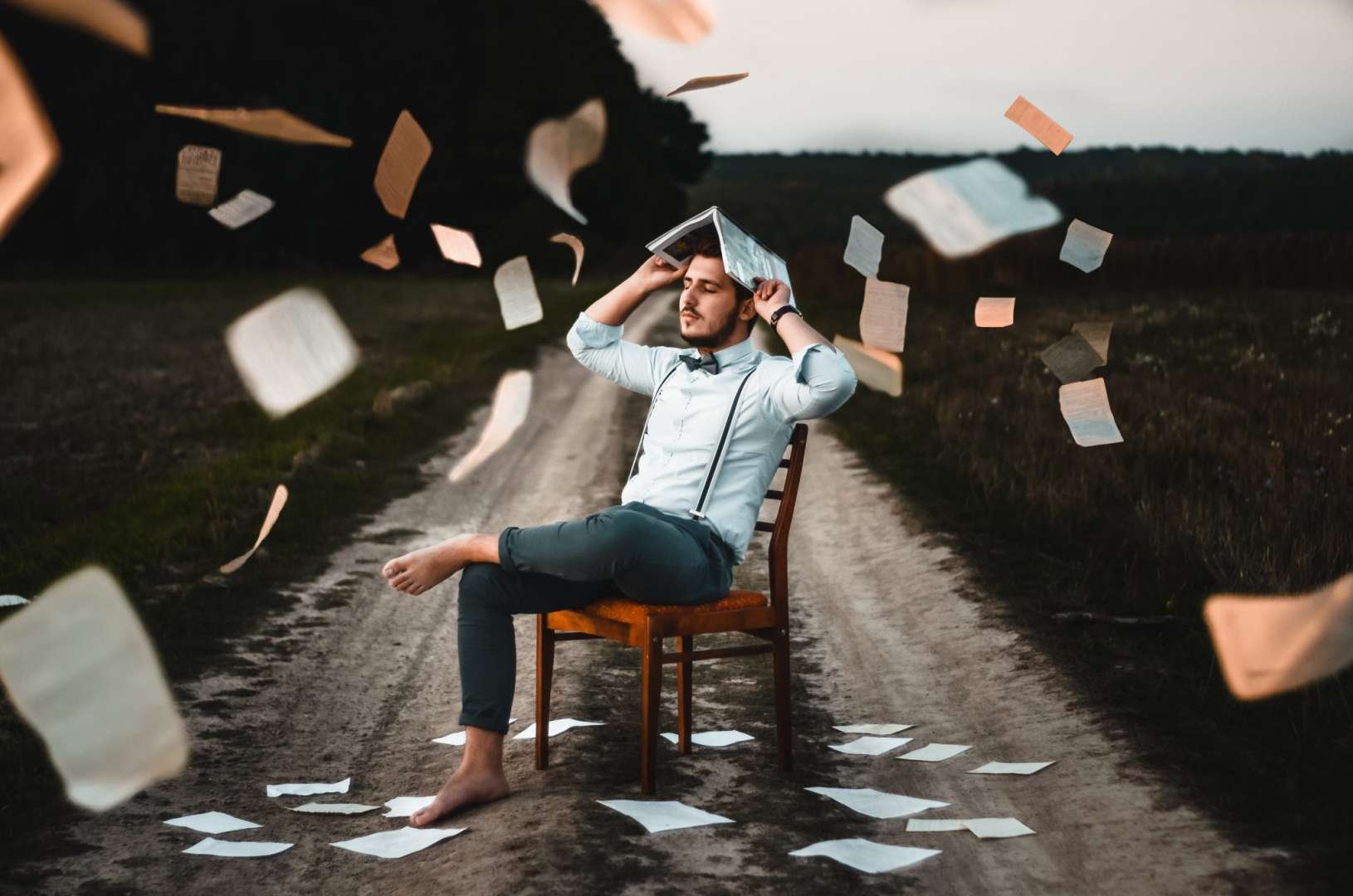 Man Surrounded By Receipts