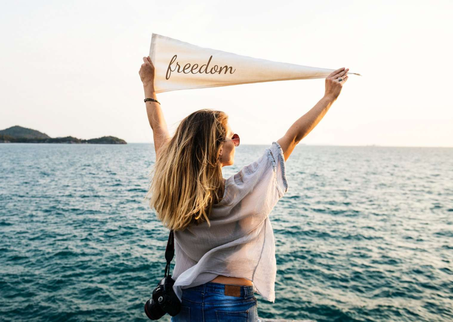 Woman Holding a Freedom Flag