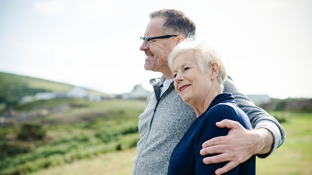 Couple standing on hill