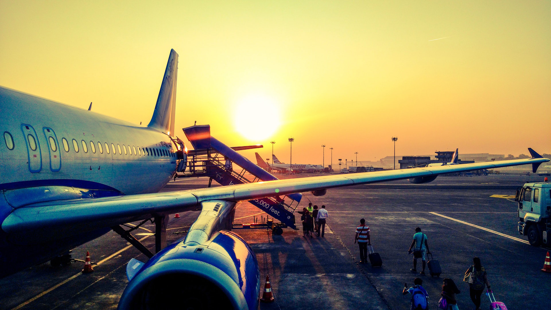 Boarding a plane at sunset