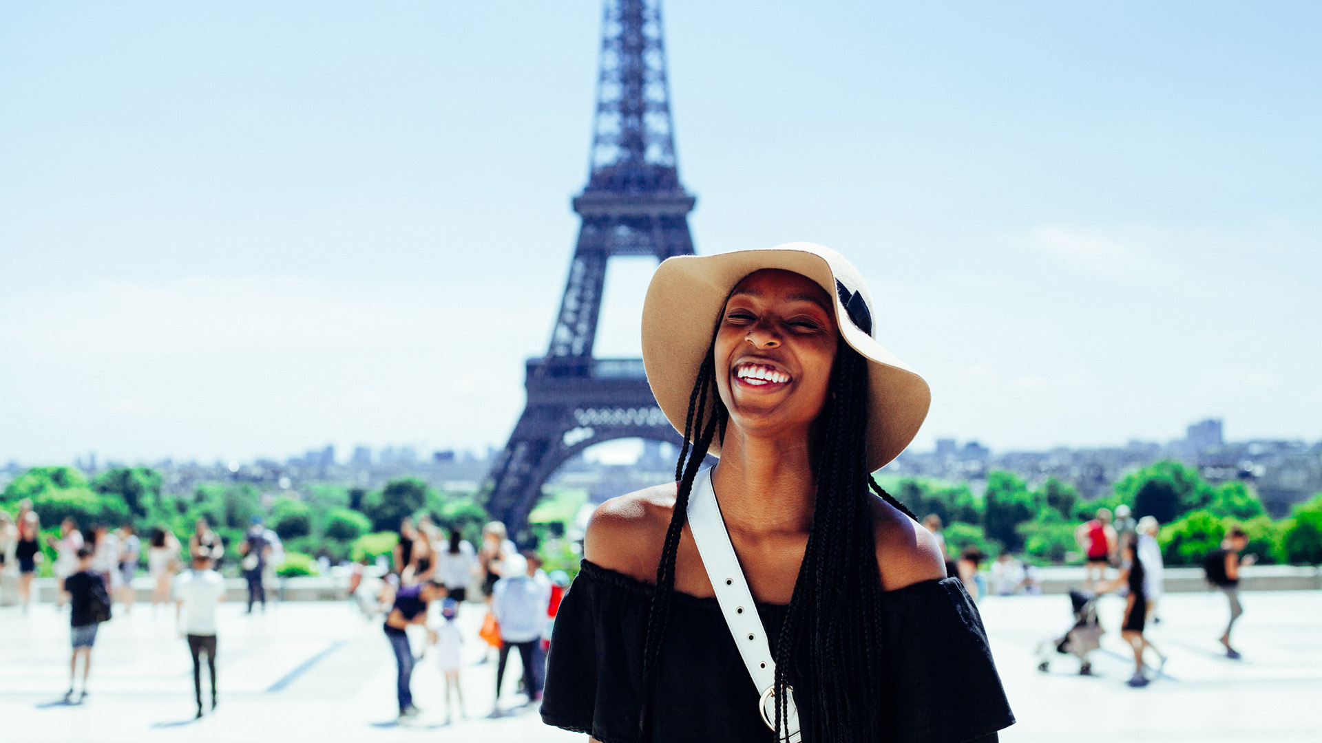 Woman Smiling In Front of Eiffel Tower