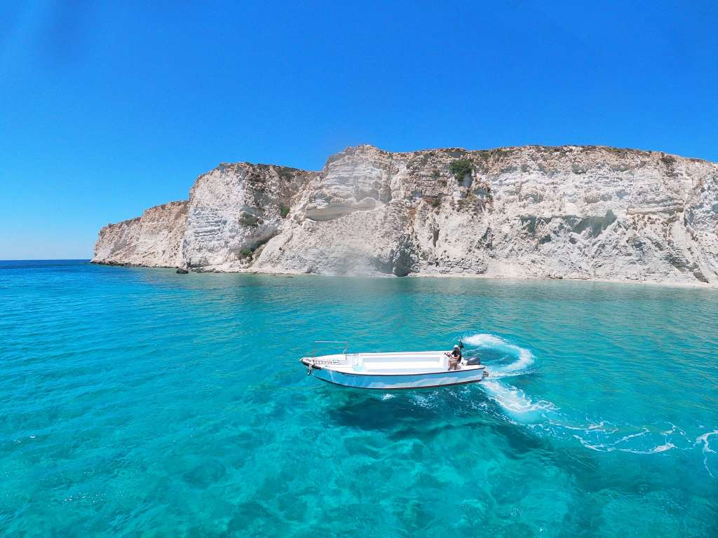 White Motorboat in Clear Water